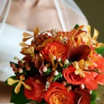 Stunning bouquet of roses, calla lilies, orchids and berries