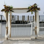 Chuppah with fall colored flower adornments